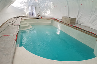 White Construction Dome - Inside view refilling pool