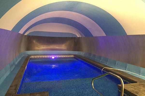 Ameri-Dome pool dome lit by a pool light