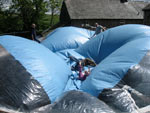 Playing on top of the play dome prior to complete inflation.