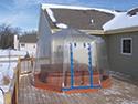 Fabrico Spa Enclosure on Snowy Deck