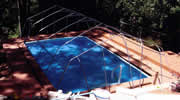Installation of Sun Dome frame on the pool