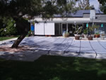 Large gray solid vinyl swimming pool cover.