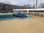 Swimming Pool Cover Holding a Car