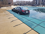 Swimming Pool Cover lifting a Car