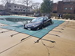 Front View Of Inground Swimming Pool Cover Holding a Car