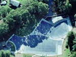 Aerial View Of Three Navy Blue Swimming Pool Covers