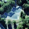 Aerial view of 3 large custom pool covers