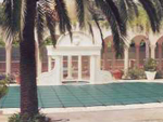 2nd photo of white house pool cover